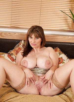 Mature beauty with big tits dildoing 1